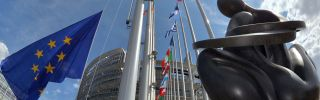 The European Union flag flying in front of the European Parliament in Strasbourg, France.