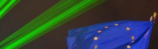 A European Union flag flies above Kiev's Maidan Square illuminated by green lights (VIKTOR DRACHEV/AFP/Getty Images)