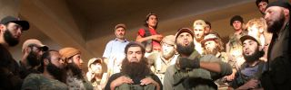 Members of Jabhat al-Nusra, an al Qaeda affiliate formerly known as Jabhat Fatah al-Sham, gather to hear a speech just south of Aleppo on Aug. 6.