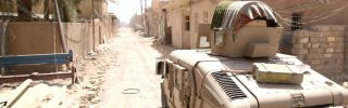 An Iraqi army Humvee on patrol in Fallujah as security forces wrest control from the Islamic State