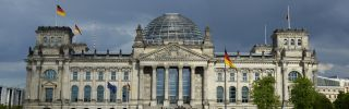 Dark clouds over the Reichstag building in Berlin may be a sign of things to come.