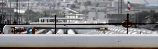 Export oil pipelines at an oil facility on Kharg Island, Iran's primary oil export terminal in the Persian Gulf. To revive Iran's hobbled economy after years of sanctions, President Hassan Rouhani is now driving an initiative to reinvigorate the oil sector.
