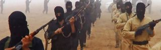 Islamic State militants march with weapons in a propaganda video. (Islamic State)