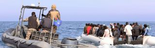 Libyan coast guard vessels detain a boat carrying migrants hoping to enter Europe illegally.