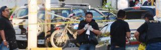 Investigators work a crime scene in Cancun, Mexico, where a gunfight erupted on Jan. 17.