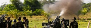 Government forces of the Sixth Infantry Division fire artillery in Maguindanao in the southern Philippines.