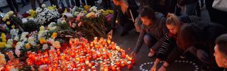 Candles commemorate the victims of a recent nightclub fire in Bucharest