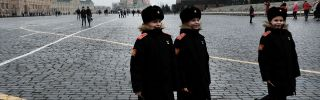 Young boys walk through Moscow's Red Square in military uniforms March 7. In Eurasia, the remnants of the Soviet era are starting to fade as more and more people are born into a post-Soviet world.