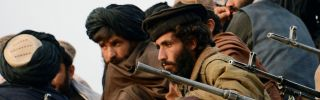 Afghan Taliban fighters listen to Mullah Mohammad Rasool Akhund (unseen), the newly appointed leader of a breakaway faction of the Taliban, at Bakwa in the western province of Farah, Nov. 3.
