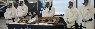 Mexican police shows off seized drugs and weapon to member of the media on February 14, 2012, in Mexico City.