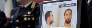 The mugshot of Hmidi Saber, a suspected member of Ansar al-Sharia is displayed at a press conference.