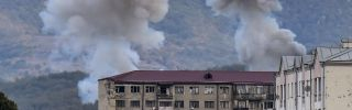Smoke rises after shelling in Stepanakert on Oct. 9, 2020, during ongoing fighting between Armenia and Azerbaijan over the disputed region of Nagorno-Karabakh.