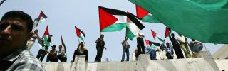 Relatives of Palestinian prisoners being held in Israeli jails wave their national flags as they attend a rally, calling for their release in 2003 in Gaza City, the Gaza Strip.