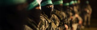 Palestinian members of the Ezzedine al-Qassam Brigades, the armed wing of the Hamas movement, take part in a gathering.