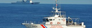 Philippine and Chinese coast guard ships sail past each other in the South China Sea on May 14, 2019.