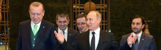 Turkey's president, Recep Tayyip Erdogan, left, welcomes Russian President Vladimir Putin, center, to Ankara on Dec. 11.