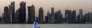 A man faces the skyline of Doha, Qatar's capital.
