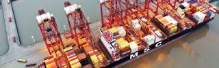 Containers sit stacked on a cargo ship berthed at China's Zhoushan Port on Feb. 4, 2020.