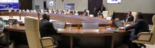 Sudanese Prime Minister Prime Minister Abdalla Hamdok (right) chairs a cabinet meeting in Khartoum on Sept. 21, 2021, in the wake of a failed coup attempt earlier that day.