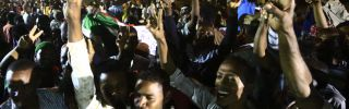 Sudanese celebrate an agreement on a civilian-majority legislative body following the removal of authoritarian leader Omar al Bashir in April 2019. The body will be in power for the next three years, after which, elections will be held to allow citizens to decide on its next composition.