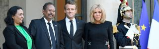 Sudanese Prime Minister Abdalla Hamdok (2L) is joined by his wife (L), economist Muna Abdalla, and French President Emmanuel Macron (C) and his spouse, Brigitte Macron (2R) in Paris on Sept. 30, 2019.