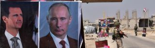Posters of Syrian President Bashar al Assad and of Russian President Vladimir Putin adorn a kiosk at a border crossing in eastern Idlib province.