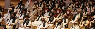 Members of the Taliban delegation attend the opening session of the peace talks