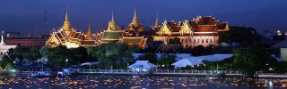 The Chaophaya river is lit by candles during a ceremony celebrating the Thailand's King Bhumibol Adulyadej.