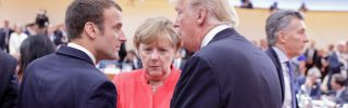 German Chancellor Angela Merkel talks with U.S. President Donald Trump and French President Emmanuel Macron at a G-20 meeting in Hamburg, Germany, in July 2017.