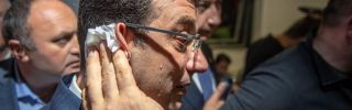 Sweat drips down the face of Ekrem Imamoglu during a news conference in Istanbul on April 9, 2019. On April 17, Imamoglu finally received the mandate to become mayor of Istanbul, more than two weeks after he won local elections.