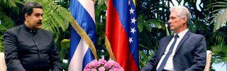 Cuban President Miguel Diaz-Canel and Venezuelan President Nicolas Maduro, left, meet at the Revolution Palace in Havana on April 21, 2018.