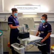 Nurses train in the COVID-19 Vaccination Clinic at the University Hospital in Coventry, England, on Dec. 4, 2020, prior to the beginning of the actual vaccination campaign.