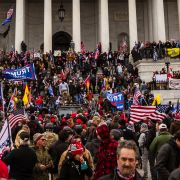 A large group of pro-Trump protesters stands on the steps of the U.S. Capitol after storming the building's grounds on Jan. 6, 2021, in Washington D.C.