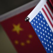 Chinese flags and American flags are displayed at a business in Beijing.