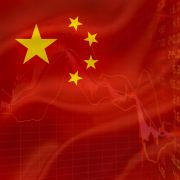 An illustration shows the Chinese flag overlaying stock prices.