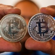 A person holds a visual representation of Bitcoin on Feb. 6, 2018, at the 'Bitcoin Change' shop in the Israeli city of Tel Aviv.