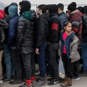 A photo of refugees and migrants waiting in line to receive blankets and food near the Greek border in Edirne, Turkey, on March 5, 2020.