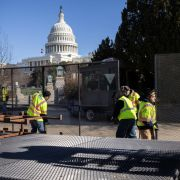 Workers build a fence around the U.S. Capitol on Jan. 7, 2021, in Washington, the day after supporters of U.S. President Donald Trump stormed the building.