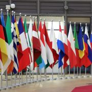 The national flags of the European Union's 27 member states are seen in the European Council headquarters in Brussels, Belgium.