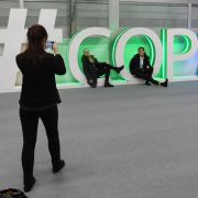 Participants pose for a picture during the final session of the COP24 summit on climate change in Katowice, Poland, on Dec. 14, 2018.