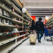 A man pulls a shopping trolley down a near-empty aisle in a supermarket in Paris, France, on March 2, 2020. Supermarket shelves in countries affected by the COVID-19 pandemic have been emptied of basic food necessities in recent weeks, such as pasta and rice.