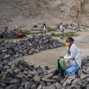 People wearing masks gather in a granite quarry in Antananarivo, Madagascar, for an Easter celebration while practicing social distancing on April 12, 2020. The capital city has been on lockdown since March 23 to curb the spread of COVID-19.
