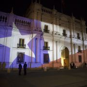 The Chilean flag is projected on the presidential palace in Santiago, Chile, on Oct. 25, 2020, after the country voted to create a new constitution.