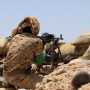 A fighter with forces loyal to Yemen's Saudi-backed government holds a position against Iran-backed Houthi rebels in the northeastern province of Marib on April 6, 2021.