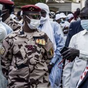 Four Star General Mahamat Idriss Deby Itno (center), son of late Chadian President Idriss Deby Itno, is seen at a polling station in N'djamena on April 11, 2021.