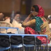 A patient rests at a banquet hall that's been converted into a COVID-19 ward in New Delhi, India, on April 27, 2021.