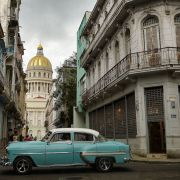 An old American car passes by the capitol building in Havana, Cuba, on May 3, 2021.