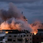 Smoke billows above buildings following an Israeli airstrike on Gaza City on May 20, 2021.