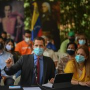Venezuelan opposition leader Juan Guaido (center) speaks during a press conference at a park in Caracas on June 30, 2021.