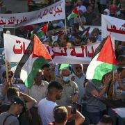 Palestinian protesters rally in Ramallah city on July 17, 2021, denouncing the Palestinian Authority after activist Nizar Banat died while in the custody of its security forces.